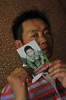 Li Fa Ming, 35, holds a photograph of his daughter, Li Xiang Xiang, aged two and a half, when stolen April 1st 2009, from the suburbs of Kunming city.  Girls in China are increasingly targeted and stolen as there is a shortage of wives as the gender imbalance widens with 120 boys for every 100 girls..PHOTO BY SINOPIX