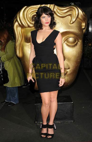 GEMMA ARTERTON .British Academy Children's Film and Television Awards at the London Park Lane Hilton, Park Lane, England, UK, November 30th 2008..BAFTA BAFTA's full length black Preen dress belted shoes open toe heels clutch bag .CAP/CAS.©Bob Cass/Capital Pictures