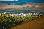 The Missoula, Montana valley with the buildings of the University of Montana above the trees