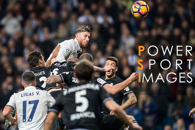 Sergio Ramos of Real Madrid competes for the ball with RC Deportivo La Coruna's players during the La Liga match between Real Madrid and RC Deportivo La Coruna at the Santiago Bernabeu Stadium on 10 December 2016 in Madrid, Spain. Photo by Diego Gonzalez Souto / Power Sport Images