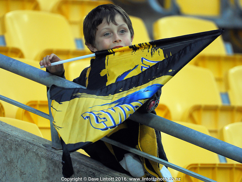 A fan gets peckish before the Super Rugby match between the Hurricanes and Southern Kings at Westpac Stadium, Wellington, New Zealand on Friday, 25 March 2016. Photo: Dave Lintott / lintottphoto.co.nz