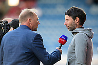 Lincoln City manager Danny Cowley, right, is interviewed for Sky Sports prior to the game<br /> <br /> Photographer Chris Vaughan/CameraSport<br /> <br /> The Carabao Cup First Round - Huddersfield Town v Lincoln City - Tuesday 13th August 2019 - John Smith's Stadium - Huddersfield<br />  <br /> World Copyright © 2019 CameraSport. All rights reserved. 43 Linden Ave. Countesthorpe. Leicester. England. LE8 5PG - Tel: +44 (0) 116 277 4147 - admin@camerasport.com - www.camerasport.com