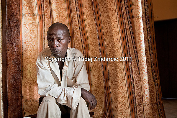Steven Sebiragala, husband of the late Sylvia Nalubowa, at his mother's house in Soweto village, Mityana District, Uganda. Sylvia Nalubowa died during childbirth in Mityana hospital in August 2009. She was giving birth to twins and one of the twins also died during childbirth..