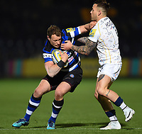 Jack Wilson of Bath Rugby fends Francois Hougaard of Worcester Warriors. Aviva Premiership match, between Worcester Warriors and Bath Rugby on January 5, 2018 at Sixways Stadium in Worcester, England. Photo by: Patrick Khachfe / Onside Images