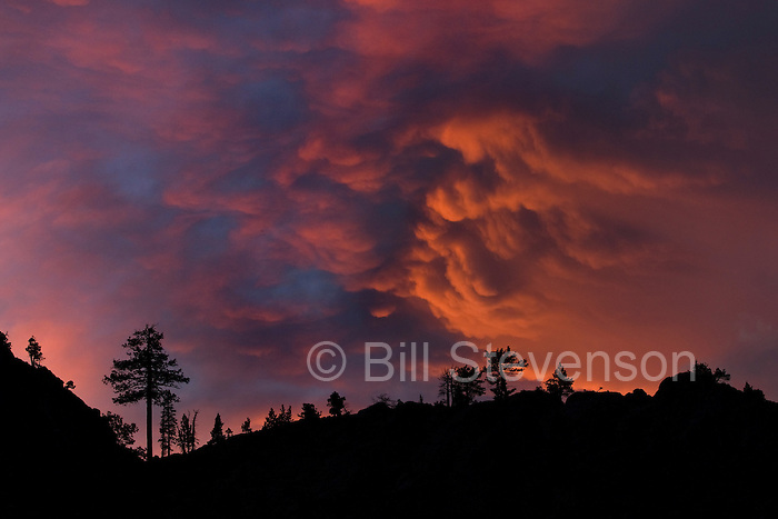 An image of cumulo Nimbus clouds at sunset above Donner Summit, CA. The setting sun casting beautiful light on on clouds above Donner Summit in the Sierra mountains near Truckee, CA.