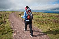 Single female hiker walking north on Offa's Dyke Path, near Hay Bluff, Black mountains, Wales