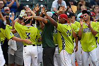 Michael Paez of the Columbia Fireflies (3) is greeted by South teammates after the first round of the Home Run Derby as part of of the South Atlantic League All-Star Game festivities on Monday, June 19, 2017, at Spirit Communications Park in Columbia, South Carolina. (Tom Priddy/Four Seam Images)