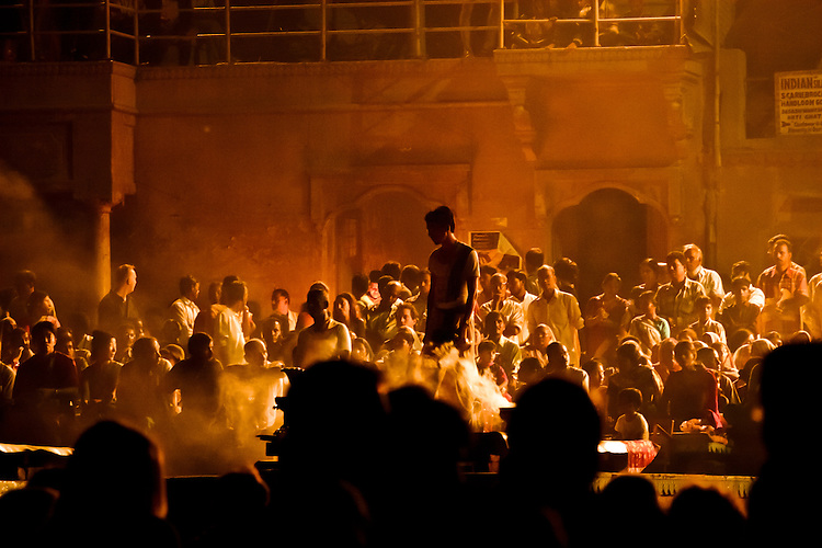 Full moon, night ceremony in honor of mother Ganges.  Varanasi, India, Asia.  ..Even though this ceremonies are attended by hordes of tourists, they remain a true manifestation for locals to express their devotion to the Ganges.