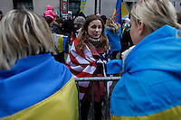 women talk about their country situation while Ukrainian immigrants take part in a protest against war in front of the Russia consulate in New York. March 2, 2014. Photo by Eduardo Munoz Alvarez/VIEWpress
