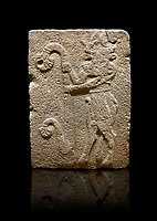 Hittite monumental relief sculpted orthostat stone panel from Water Gate Basalt, Karkamıs, (Kargamıs), Carchemish (Karkemish), 900-700 B.C. Anatolian Civilisations Museum, Ankara, Turkey. Bull-man holding the trunk of the tree. The waist-down part of the figure is in the form of a bull. <br /> <br /> On a black background.