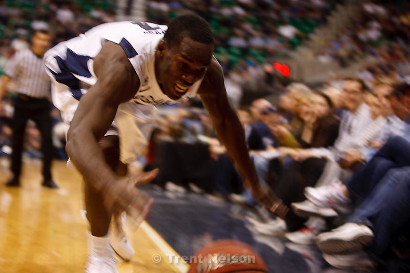 Trent Nelson  |  The Salt Lake Tribune.BYU's Charles Abouo chases a ball out of bounds, at BYU vs. Oregon, college basketball at EnergySolutions Arena in Salt Lake City, Utah, Saturday, December 3, 2011.
