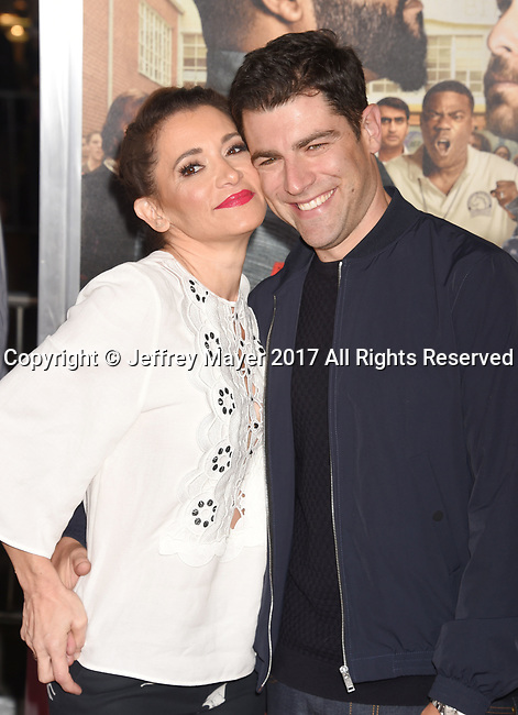 HOLLYWOOD, CA - FEBRUARY 13: Actor Max Greenfield (R) and wife Tess Sanchez attend the premiere of Warner Bros. Pictures' 'Fist Fight' at the Regency Village Theatre on February 13, 2017 in Westwood, California.