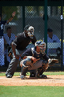 Umpire Dexter Kelley and GCL Yankees 1 catcher Jerry Seitz (78) during the first game of a doubleheader against the GCL Tigers on August 5, 2015 at Tigertown in Lakeland, Florida.  GCL Tigers derated the GCL Yankees 5-2.  (Mike Janes/Four Seam Images)