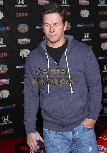 MARK WAHLBERG.IZOD IndyCar   Celebrates The 100th Anniversary Indianapolis 500  held at The Colony, Los Angeles, California, USA..April 13th, 2011.half length blue top hooded hoody hoodie hand in pocket.CAP/ADM/TC.©T. Conrad/AdMedia/Capital Pictures.