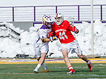 University at Albany Men's Lacrosse defeats Cornell 11-9 on Mar 4 at Casey Stadium.  John Piatelli (#41) attacks the Albany defense.
