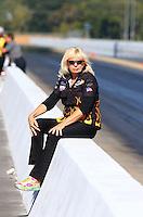 Sep 14, 2013; Charlotte, NC, USA; Wife of NHRA top fuel dragster driver Chris Karamesines during qualifying for the Carolina Nationals at zMax Dragway. Mandatory Credit: Mark J. Rebilas-