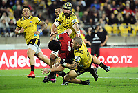 TJ Perenara tackles Matt Todd during the Super Rugby match between the Hurricanes and Crusaders at Westpac Stadium in Wellington, New Zealand on Saturday, 10 March 2018. Photo: Dave Lintott / lintottphoto.co.nz