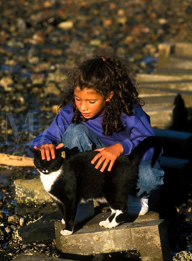 Girl petting a cat