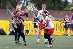 Santa Barbara, CA 02/19/11 - Angelica Acosta (Stanford #4), Isabel Greenfield (Stanford #2) and Haleh Nourani (UC Berkeley #25) in action during the Stanford - Minnesota-Duluth game at the 2011 Santa Barbara Shootout.