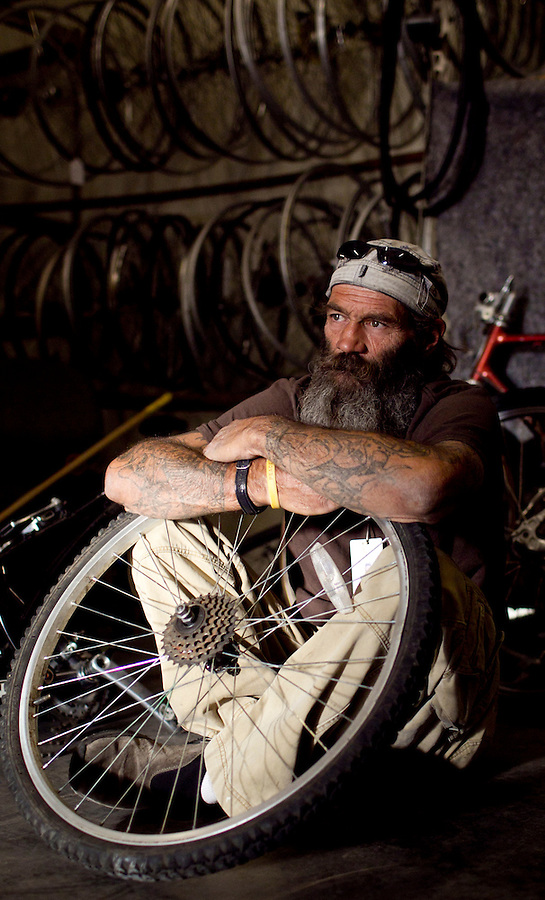 marico-homeless  167222 11/3/10-  Jeff McClure (CQ), known to his friends as Dragon, runs a bike repair shop at Central Arizona Shelter Services. After being homeless for many year he is now able to pay for an apartment with the money he makes at the repair shop. (Pat Shannahan/ The Arizona Republic(