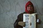 Man playing accordion along street during winter downtown Seattle Washington State USA