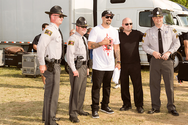 May 8, 2016. Concord, North Carolina. <br />  Even State Troopers, and David Draiman of Disturbed, are Cypress Hill fans. B-Real at center.<br />  The 2016 Carolina Rebellion was held over May 6-8 next to the Charlotte Motor Speedway and featured over 50 bands including headliners Lynyrd Skynyrd, The Scorpions, Five Finger Death Punch, Disturbed, and Rob Zombie.
