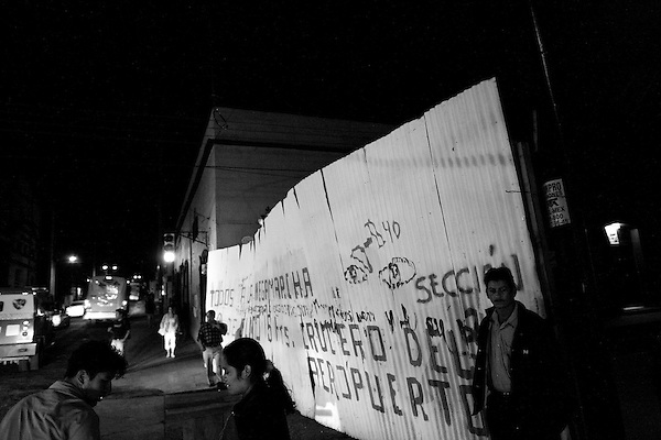 The teachers in the southern state of Oaxaca have been on strike for over 40 days demanding better pay and benefits. On July 14th, the state police raided the encampment in the center of town and were repelled after leaving one child dead and many other wounded. In support, many other social justice groups have rallied in support and have staged a virtual takeover of the main squaare in the state's capitol city.