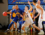 SIOUX FALLS, SD - NOVEMBER 28: Alex Arians #34 from South Dakota State University defends as Jordan Giles #5 from UMKC dribbles to the basket during their game Wednesday night at Frost Arena in Brookings, SD. (Photo by Dave Eggen/Inertia)