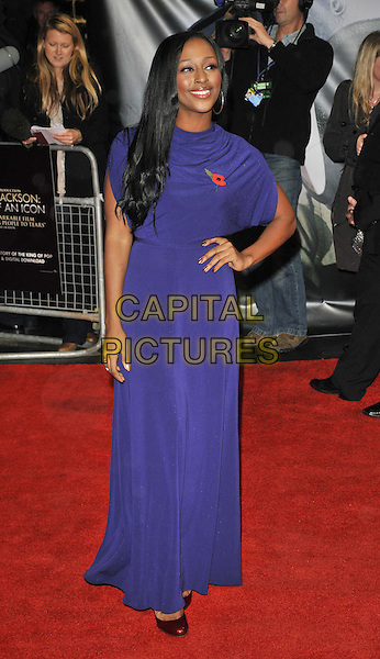 "Alexandra Burke .The ""Michael Jackson : The Life Of An Icon"" UK premiere, Empire cinema, Leicester Square, London, England..2nd November 2011.full length purple dress hand on hip poppy.CAP/CAN.©Can Nguyen/Capital Pictures."