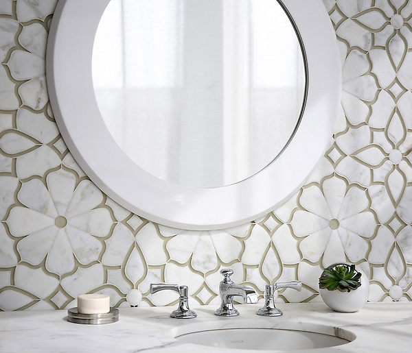 Estelle, a handmade mosaic shown in Venetian honed Calacatta Gold and Weathered White Serenity glass, is part of the Parterre Collection by by Paul Schatz for New Ravenna.