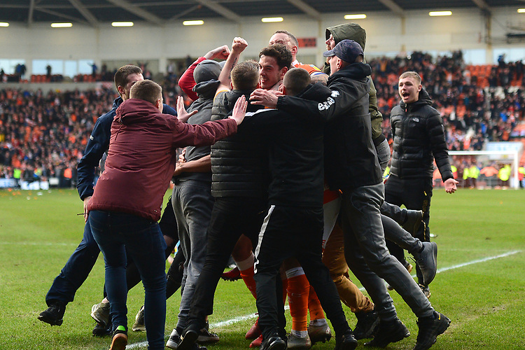 Blackpool's Ben Heneghan is mobbed by fans afterTaylor Moore of Southend United scored an own goal<br /> <br /> Photographer Richard Martin-Roberts/CameraSport<br /> <br /> The EFL Sky Bet League One - Blackpool v Southend United - Saturday 9th March 2019 - Bloomfield Road - Blackpool<br /> <br /> World Copyright © 2019 CameraSport. All rights reserved. 43 Linden Ave. Countesthorpe. Leicester. England. LE8 5PG - Tel: +44 (0) 116 277 4147 - admin@camerasport.com - www.camerasport.com