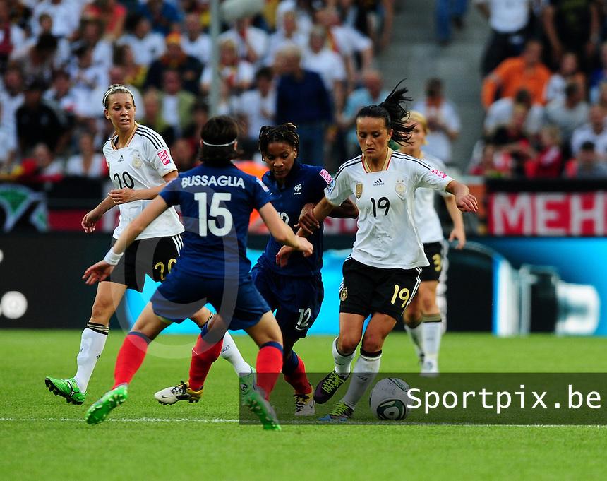 Fifa Women's World Cup Germany 2011 : France - Germany ( Frankrijk - Duitsland ) at Munchengladbach World Cup stadium : Fatmire BAJRAMAJ aan de bal.foto DAVID CATRY / Vrouwenteam.be