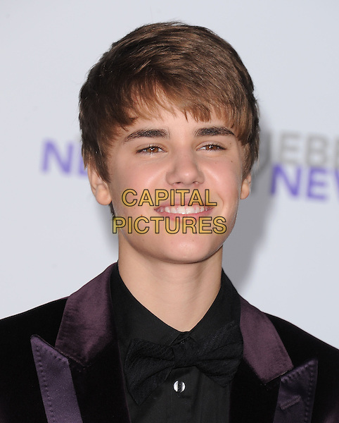 "JUSTIN BIEBER .attending the Paramount Pictures' L.A. Premiere of ""Justin Bieber: Never Say Never"" held at The Nokia Theater Live in Los Angeles, California, USA,.February 8th 2011..portrait headshot purple brown velvet black shirt jacket smiling .CAP/RKE/DVS.©DVS/RockinExposures/Capital Pictures."