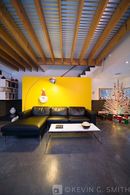 Living room in a modern style home decorated for christmas, 60's retro aluminum Christmas tree.