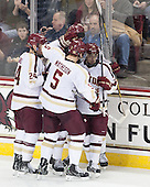 Bill Arnold (BC - 24), Michael Matheson (BC - 5), Johnny Gaudreau (BC - 13) - The Boston College Eagles defeated the visiting University of New Hampshire Wildcats 5-2 on Friday, January 11, 2013, at Kelley Rink in Conte Forum in Chestnut Hill, Massachusetts.