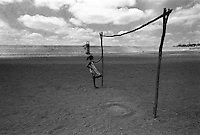 Girl in the center of dry dam used as soccer field. Sertão, back country, Notheastern Brazil. Açude do Estado ( State dam ), completely dry. Soledade city, State: Paraiba.
