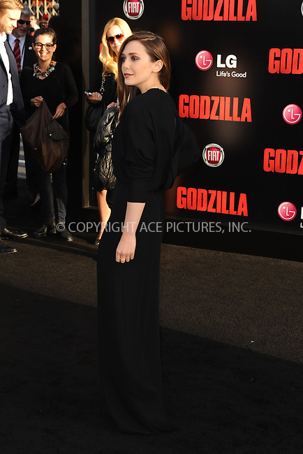 ACEPIXS.COM<br /> <br /> May 8 2014, LA<br /> <br /> Actress Elizabeth Olsen arriving at the Los Angeles premiere of 'Godzilla' at Dolby Theatre on May 8, 2014 in Hollywood, California. <br /> <br /> By Line: Peter West/ACE Pictures<br /> <br /> ACE Pictures, Inc.<br /> www.acepixs.com<br /> Email: info@acepixs.com<br /> Tel: 646 769 0430