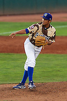 Ogden Raptors relief pitcher Ricky Perez (12) delivers a pitch to the plate against the Great Falls Voyagers at Lindquist Field on August 16, 2013 in Ogden Utah. Military Appreciation Night saw the Raptors take the field in camouflage uniforms. (Stephen Smith/Four Seam Images)