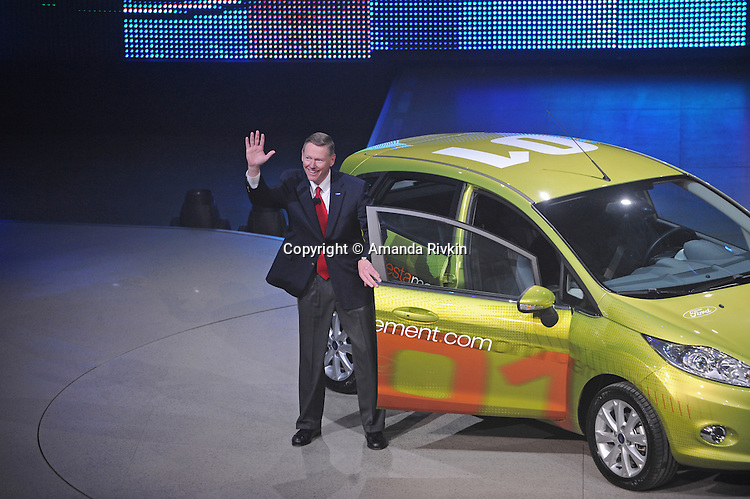 Alan Mulally, CEO of Ford, exits the Ford Fiesta during the Ford presentation at the Detroit Auto Show on January 11, 2009.