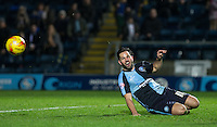 Sam Wood of Wycombe Wanderers watches as the ball flys past following a missed opportunity during the Sky Bet League 2 match between Wycombe Wanderers and Crawley Town at Adams Park, High Wycombe, England on 28 December 2015. Photo by Andy Rowland / PRiME Media Images