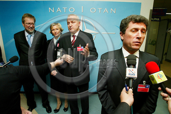BRUSSELS - BELGIUM - 04 APRIL 2004--From left Mr. Per Stig MOELLER (Moller, M¿ller), Minister of Foreign Affairs of Denmark, Mrs. Kristiina OJULAND, Minister of Foreign Affairs of Estonia, Mr. Rihards PIKS, Foreign Minister of Latvia and Mr. Antanas VALIONIS, Minister of Foreign Affairs of Lithuania after NATO celebrated the entry of seven new former communist countries. -- PHOTO: ERIK LUNTANG / EUP-IMAGES