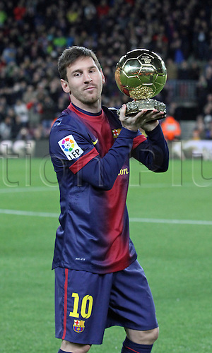 16.01.2013 Barcelona, Spain. Leo Messi presents his latest Ballon d'or trophy to the club supporters at the Camp Nou