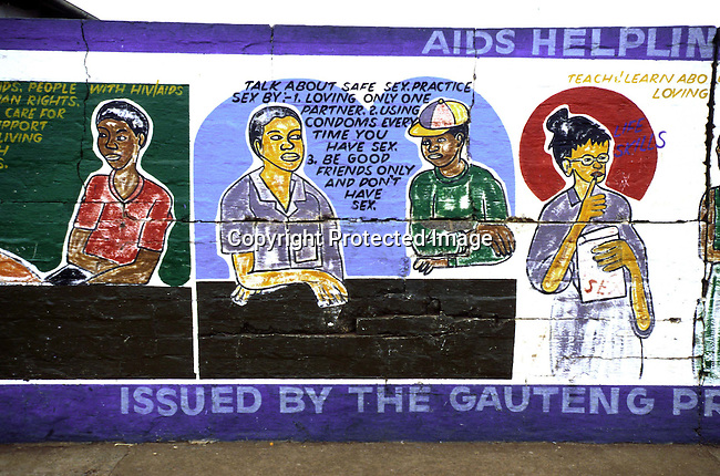 disiaids00257  Social Issues, Aids: Aids education. A mural informing the public on the risks of HIV-Aids on June 16, 2000 in a residential area in Thokosa, a township outside Johannesburg, South Africa. About 4,5 million (About 10 percent of the population) South Africans are living with HIV-Aids. Safe sex, helpline.©Per-Anders Pettersson/ iAfrika Photos