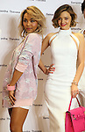 March 16, 2016, Tokyo, Japan - Australian actress Miranda Kerr (R) and American Korean singer Crystal Kay (L) pose as they attend a promotoin event of Japanese handbag maker Samantha Thavasa at the company's shop in Tokyo on Wednesday, March 16, 2016. American Korean singer Crystal kay attended the event as she sings an image song for the latest commercial film.   (Photo by Yoshio Tsunoda/AFLO) LWX -ytd-