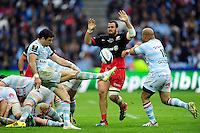 Mike Phillips of Racing 92 box-kicks the ball as Juan Figallo of Saracens looks to charge him down. European Rugby Champions Cup Final, between Saracens and Racing 92 on May 14, 2016 at the Grand Stade de Lyon in Lyon, France. Photo by: Patrick Khachfe / Onside Images