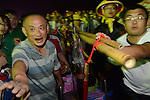 Donggang, Taiwan -- Worshipers pushing through for a final offering of good wishes.