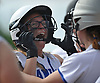 Katie Frisch #25 of Long Beach reacts as she gets mobbed by teammates after connecting for a game-tying two-run home run in the bottom of the third inning of Game 2 of the best-of-three Nassau County varsity softball Class AA final against East Meadow at Mitchel Athletic Complex on Wednesday, May 24, 2017. Long Beach never trailed again in the game and went on to win 8-6 to even the series 1-1.