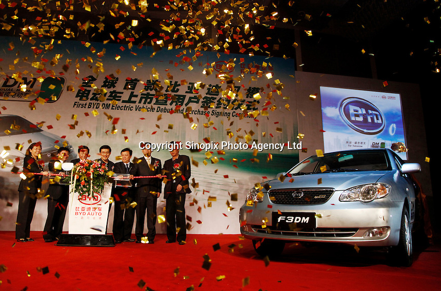 BYD executives and local officials unveil BYD's new F3 Dual Mode (DM) vehicle in Shenzhen, China..15 Dec 2008.