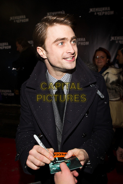 "Daniel Radcliffe.Premiere of ""The Woman in Black"", Moscow, Russia..February 15th, 2012.half length black blue coat signing autographs.CAP/PER/SB.©SB/PersonaStars/Capital Pictures."