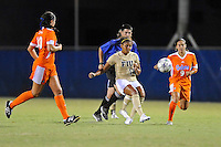21 August 2011:  FIU's Scarlett Montoya (10) passes the ball while being pursued by Florida's Tohnai Annis (9) and Holly King (10) in the second half as the University of Florida Gators defeated the FIU Golden Panthers, 2-0, at University Park Stadium in Miami, Florida.